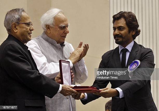 President Pranab Mukherjee presenting Special Jury award to Nawazuddin Siddiqui during 60th National Film Awards on May 03 2013 in New Delhi India...