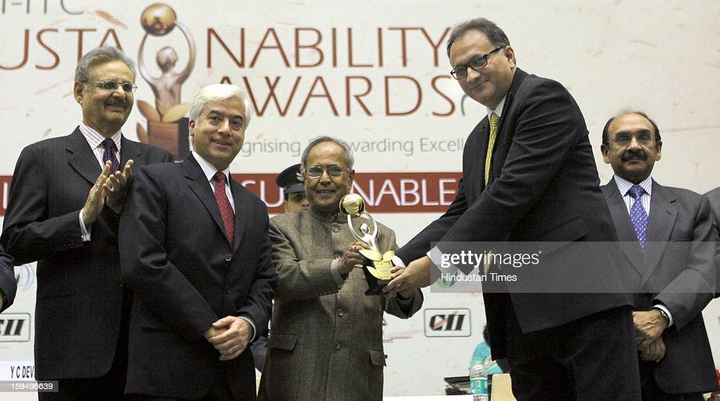 President Pranab Mukherjee presenting the Sustainability Awards 2012 to Amir Alvi Vice President TATA Chemicals Ltd, As YC Deveshwar and Ajay S Shriram look on at Vigyan Bhawan on January 14, 2013 in New Delhi, India.