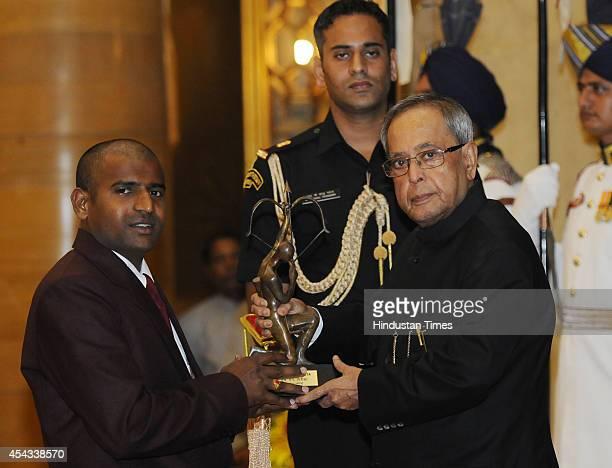 President Pranab Mukherjee presents Arjuna Award 2014 to Para Athlete Girisha Hosanagara Nagarajegowda at the National Sports and Adventure Awards...