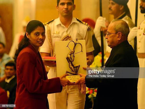 President Pranab Mukherjee presents Arjuna Award to Athlete Lalita Babar at the National Sports and Adventure Awards function at Rashtrapati Bhawan...