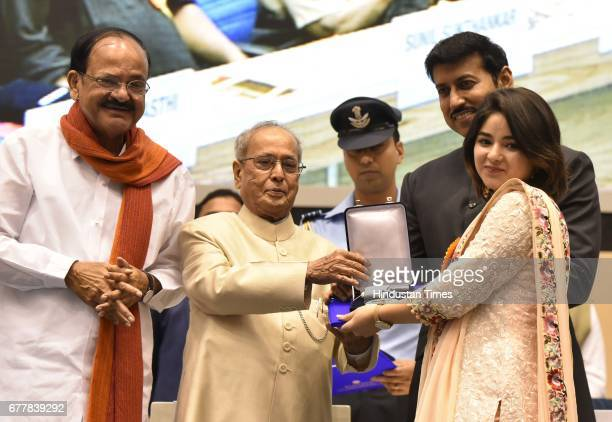 President Pranab Mukherjee presents Best Supporting Actor award to actor Zaira Wasim for movie Dangal during the 64th National Film Awards at Vigyan...