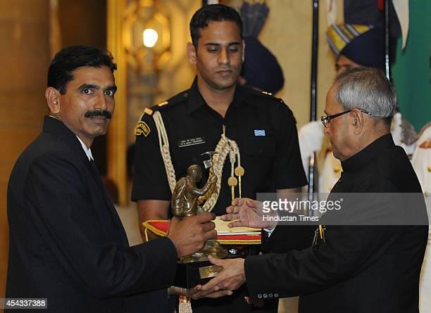 President Pranab Mukherjee presents Tenzing Norgay Award 2014 to Para Jumper MWO Surender Singh at the National Sports and Adventure Awards function...