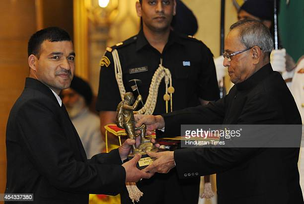 President Pranab Mukherjee presents Tenzing Norgay Award 2014 to Mountaineer Subedar Jagat Singh at the National Sports and Adventure Awards function...