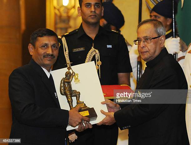 President Pranab Mukherjee presents Tenzing Norgay Award 2014 to Wing Commander Amit Chowdhury at the National Sports and Adventure Awards function...