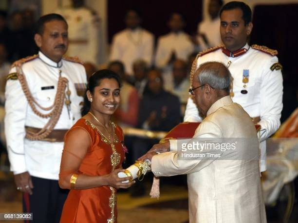 President Pranab Mukherjee presents the Padma Shri Award to Dipa Karmakar artistic gymnast during the Padma Awards 2017 Investiture Ceremony Part2 at...