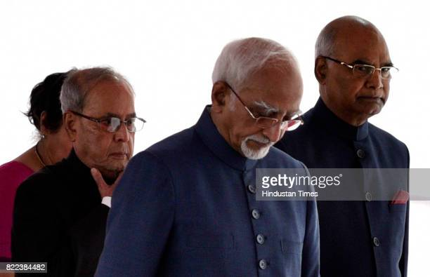 President Pranab Mukherjee Presidentelect Ram Nath Kovind and Vice President Hamid Ansari in a ceremonial procession at Parliament House for the...