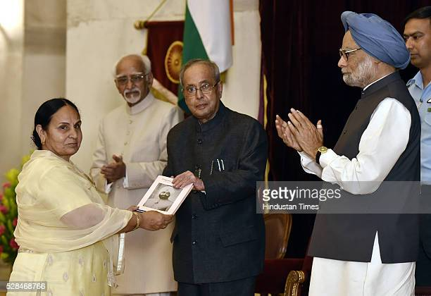 President Pranab Mukherjee receiving the first copy of Fragrant Recollections from Dr Gurdeep Kaur Daughter of Zail Singh as Vice President Hamid...