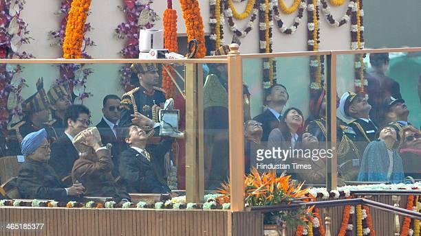 President Pranab Mukherjee takes salute as Prime Minister Manmohan Singh Vice President Hamid Ansari and chief guest Japanese Prime Minister Shinzo...