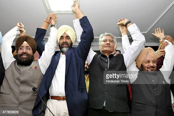 PPCC President Pratap Singh Bajwa PPP Chief Manpreet Badal CLP leader Sunil Jakhar and Senior Punjab Congress leader Lal Singh showing solidarity at...