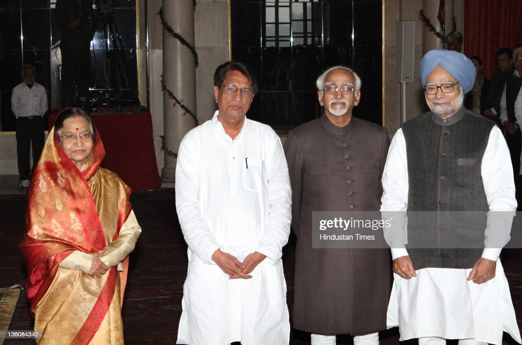 President Pratibha Devi Singh Patil, Vice-President Hamid Ansari, Prime Minister Manmohan Singh with new Cabinet Minister Ajit Singh (2L) after his swearing-in ceremony at the Rashtrapati Bhawan on December 18, 2011 in New Delhi, India. Ajit Singh was given charge of Ministry of Civil Aviation.