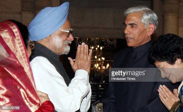 President Pratibha Patil and Prime Minister Manmohan Singh with new Comptroller and Auditor General Vinod Rai and his wife during his oath taking...