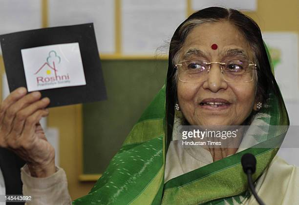President Pratibha Patil attends an exhibition of logos from country wide students for Roshni at the President House on May 30 2012 in New Delhi India