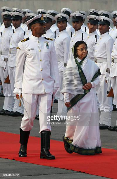 President Pratibha Patil inspects a guard of honor during Fleet Review 2011on December 20 2011 in Mumbai India A total of 81 ships including over 60...