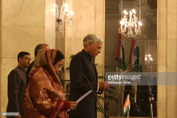 President Pratibha Patil [ Left] with new Comptroller and Auditor General Vinod Rai during his oath taking ceremony at Rashtrapati Bhawanat...