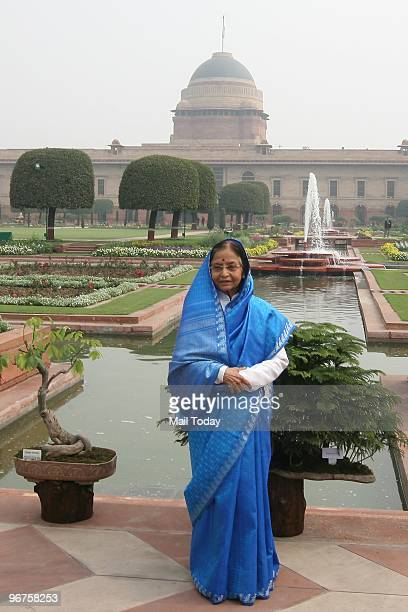 President Pratibha Patil poses with the flowers in full bloom at the Mughal Gardens in the backyard of the Rashtrapati Bhawan in New Delhi on...