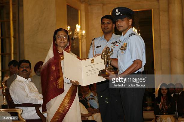 President Pratibha Patil presents 'Tenzing Norgay National Adventure Award 2009' to Sqn Ldr Ramakant during the Sports and Adventure Awards ceremony...