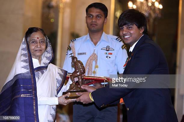 President Pratibha Patil presents the Tenzing Norgay National Adventure award to Sufyan Shaikh during a function at Rashtrapati Bhavan in New Delhi...