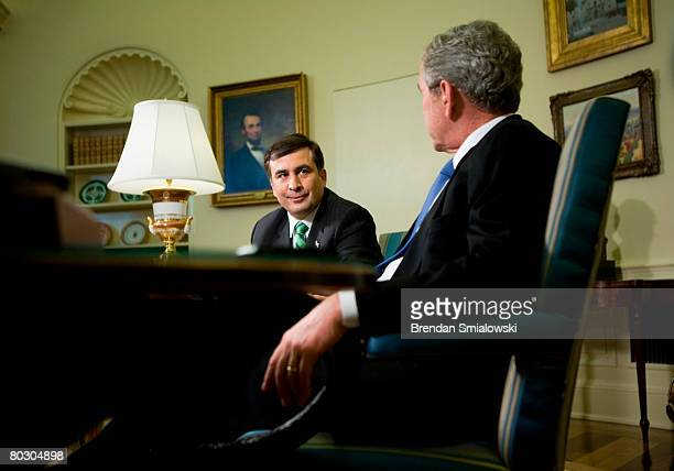 President President Mikheil Saakashvili of Georgia listens to US President George W Bush speak to the press after a meeting in the Oval Office of the...