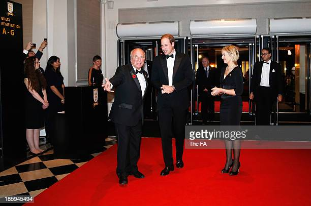 President Prince William, Duke of Cambridge is welcomed by Greg Dyke, FA Chairman as he arrives during the FA150 Gala Dinner commemorating the...