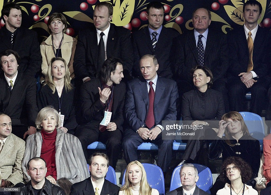 President Putin talks with former world figure champion Iliya Averbukh at the opening ceromony during the ISU World Figure Skating Championships at the Lunzhiki Sports Palace on March 13, 2005 in Moscow, Russia.