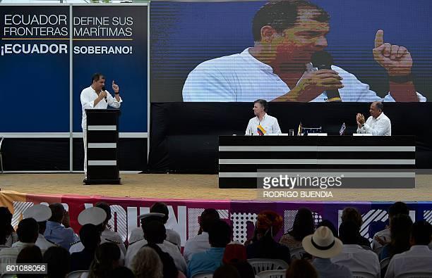 President Rafael Correa of Ecuador delivers a speech accompanied by Presidents Juan Manuel Santos of Colombia and Luis Guillermo Solis of Costa Rica...