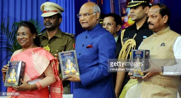 President Ram Nath Kovind along with Governor Draupadi Murmu Chief Minister Raghubar Das releasing the holy book Bhagwad Geeta Hindi version God...