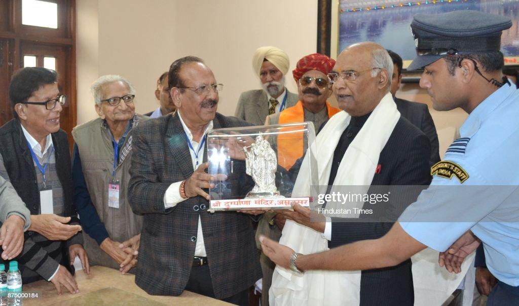 President Ram Nath Kovind being honoured by Durgiana Committee president Ramesh Sharma during his visits at Durgiana Temple on November 16 2017 in...
