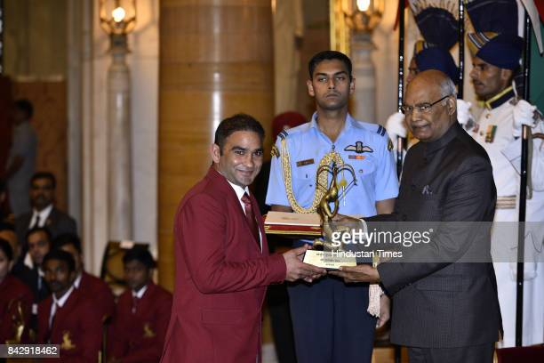 President Ram Nath Kovind confers the Arjuna Award award to Kabaddi player Jasvir Singh at a function at Rashtrapati Bhawan here on the occasion of...