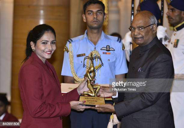 President Ram Nath Kovind confers the Arjuna award to Basketball player Prashanti Singh at a function at Rashtrapati Bhawan here on the occasion of...