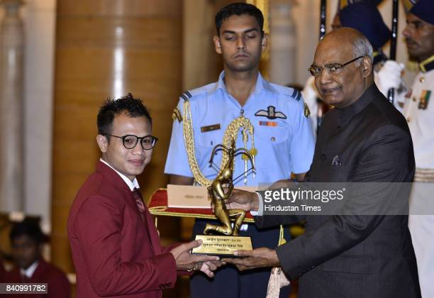 President Ram Nath Kovind confers the Arjuna award to Boxer L Debendro Singh at a function at Rashtrapati Bhawan here on the occasion of National...