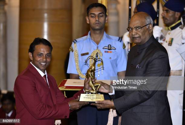 President Ram Nath Kovind confers the Arjuna award to Golf player Shivsankar Prasad Chawrasia at a function at Rashtrapati Bhawan here on the...