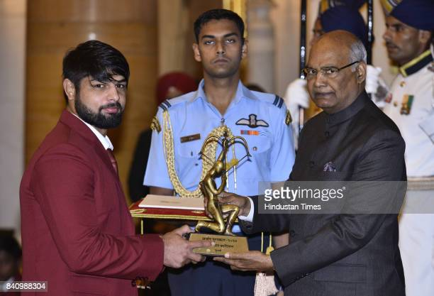 President Ram Nath Kovind confers the Arjuna award to wrestler Satyawart Kadian at a function at Rashtrapati Bhawan here on the occasion of National...
