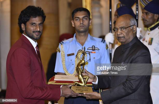 President Ram Nath Kovind confers the Arjuna Awards to Tennis player Saketh Myneni at a function at Rashtrapati Bhawan here on the occasion of...