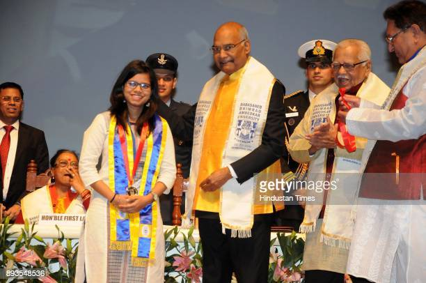 President Ram Nath Kovind giving medal to topper Richa Verma at the 7th convocation of Babasaheb Bhimrao Ambedkar University on December 15 2017 in...