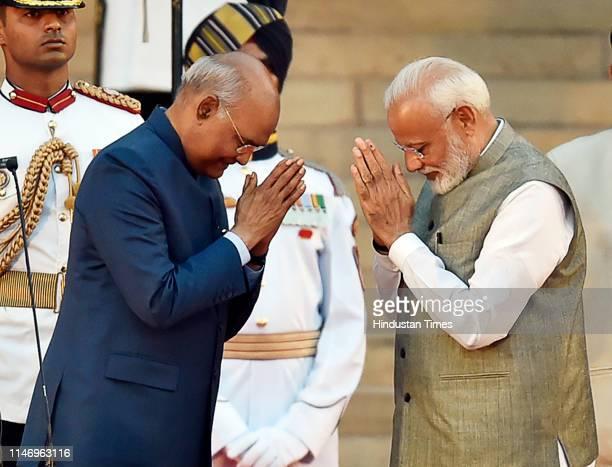 President Ram Nath Kovind greets Prime Minister Narendra Modi before taking oath during the swearingin ceremony at the forecourt of Rashtrapati...
