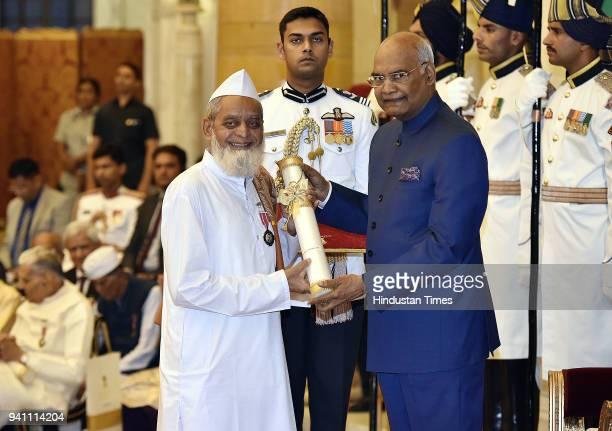 President Ram Nath Kovind presenting Padma Shri award to Sufi bhajan singer Ibrahim Nabisaheb Sutar during the Civil Investiture Ceremony at...