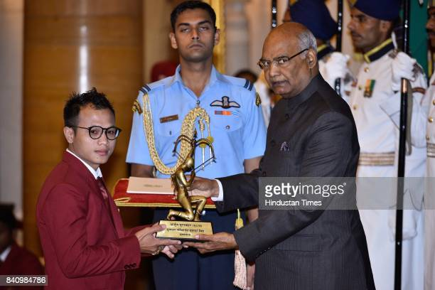 President Ram Nath Kovind presents the Arjuna Award 2017 to L Debendro Singh for Boxing in a glittering ceremony at Rashtrapati Bhavan on August 29...