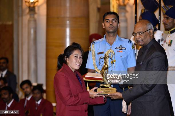 President Ram Nath Kovind presents the Arjuna Award 2017 to Oinam Bembem Devi for Football in a glittering ceremony at Rashtrapati Bhavan on August...