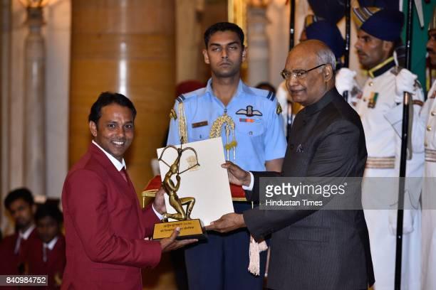 President Ram Nath Kovind presents the Arjuna Award 2017 to Shivsankar Prasad Chawrasia for Golf in a glittering ceremony at Rashtrapati Bhavan on...