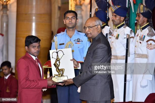 President Ram Nath Kovind presents the Arjuna Award 2017 to Mariyappan T for ParaAthletics in a glittering ceremony at Rashtrapati Bhavan on August...