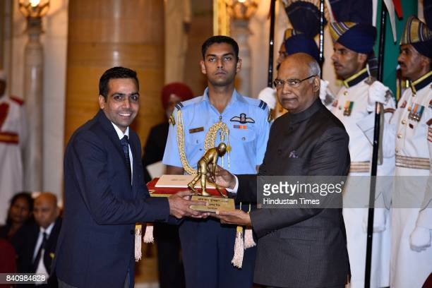President Ram Nath Kovind presents the he Dhyan Chand Award 2017 to Bhupender Singh for Athletics in a glittering ceremony at Rashtrapati Bhavan on...