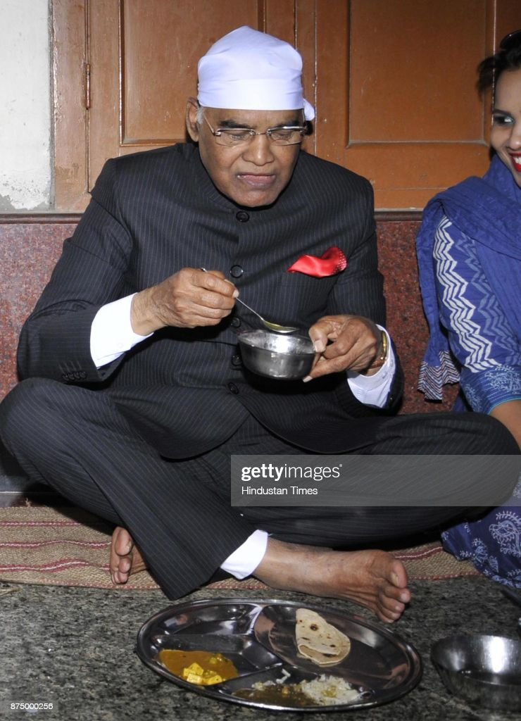 President Ram Nath Kovind taking food at Langar hall during paying obeisance at Golden Temple on November 16 2017 in Amritsar India