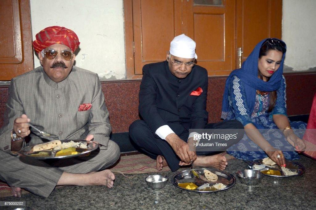 President Ram Nath Kovind with his daughter Swati Kovind and Punjab governor VP Singh Badnore taking food at Langar hall during paying obeisance at...