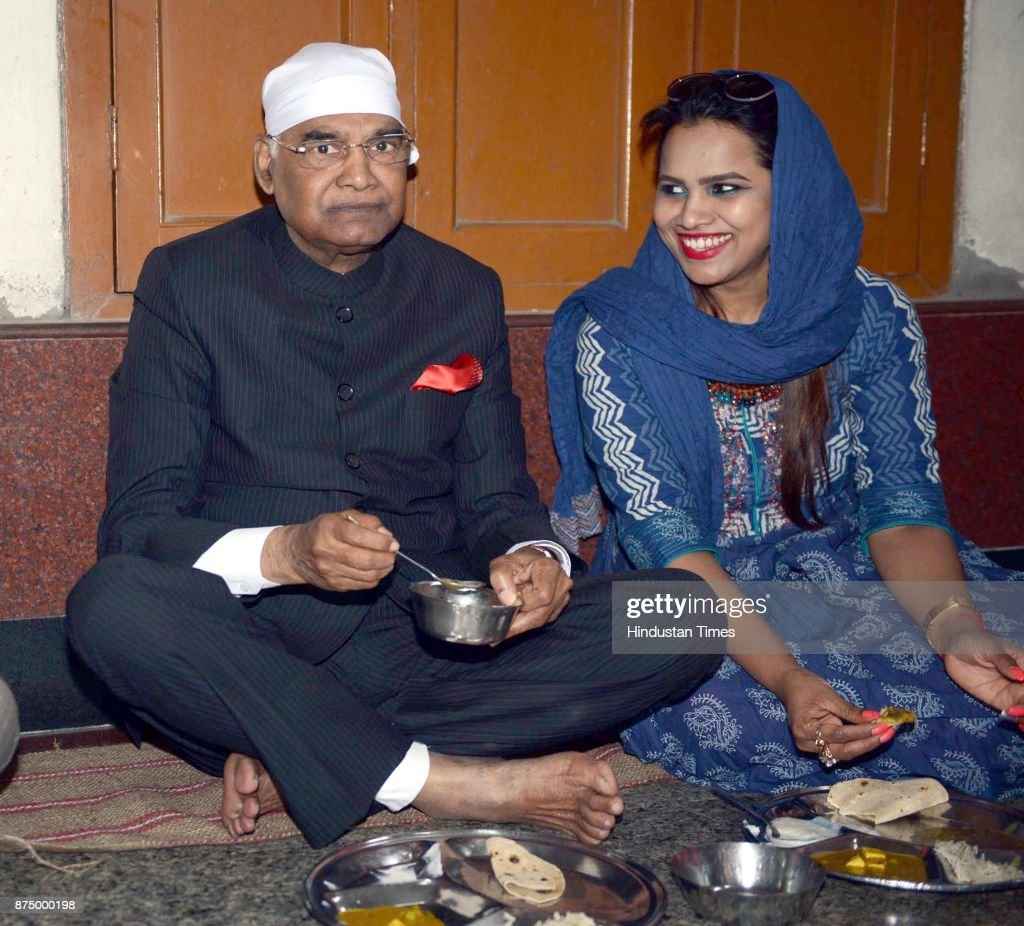 President Ram Nath Kovind with his daughter Swati Kovind taking food at Langar hall during paying obeisance at Golden Temple on November 16 2017 in...