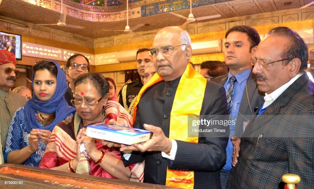 President Ram Nath Kovind with his wife Savita Kovind pays obeisance at Durgiana Temple on November 16 2017 in Amritsar India