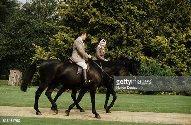 President Reagan and Nancy Reagan goes horse riding with Queen Elizabeth II of Great Britain. Queen Elizabeth II, born in London in 1926, Queen of...