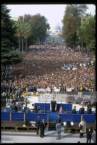 President Reagan facing supportive signbearing crowd addressing final election campaign rally running for 2nd term in WH