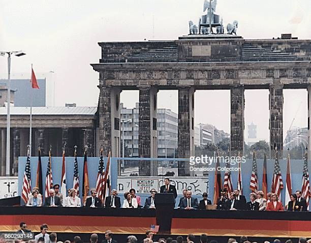 President Reagan giving a speech at the Berlin Wall in front of the Brandenburg Gate on June 12 1987 in Germany