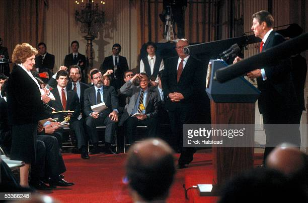 President Reagan holding news conference in WH East Room taking question from UPI's Helen Thomas with Press Secretary Fitzwater