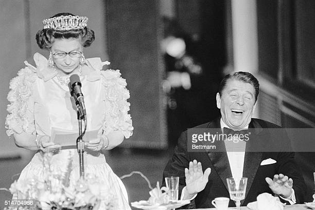 President Reagan laughs following a joke by Queen Elizabeth II, who commented on the lousy California weather she has experienced since her arrival...